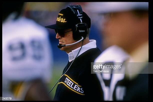Head coach Chuck Noll of the Pittsburgh Steelers looks on during a game against the Denver Broncos at Mile High Stadium in Denver Colorado The...