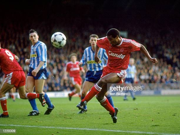 John Barnes of Liverpool volleys the ball just wide of the goal during the Barclays League Division One match against Coventry City played at Anfield...