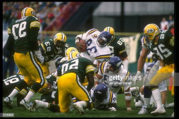 Running back Herschel Walker of the Minnesota Vikings jumps over the line during a game against the Green Bay Packers at Milwaukee County Stadium in...