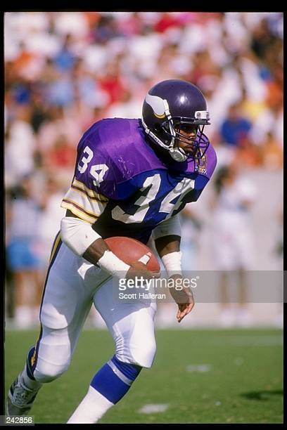 Running back Herschel Walker of the Minnesota Vikings runs with the ball during a game against the Tampa Bay Buccaneers at Tampa Stadium in Tampa...