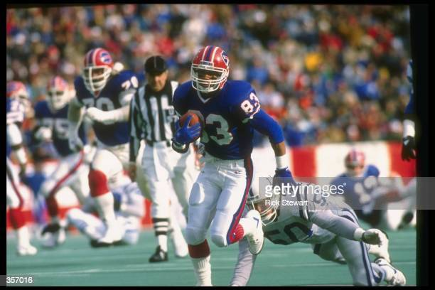 Wide receiver Andre Reed of the Buffalo Bills runs with the ball during a game against the Indianapolis Colts at Rich Stadium in Orchard Park New...