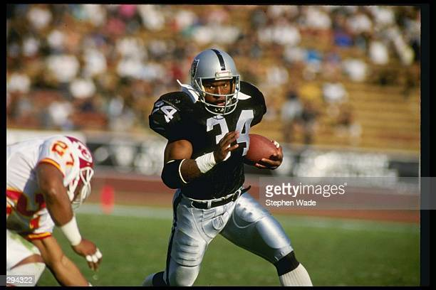 Running back Bo Jackson of the Los Angeles Raiders runs down the field during a game against the Kansas City Chiefs at the Los Angeles Coliseum in...