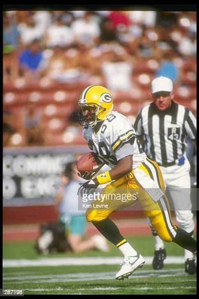 Wide receiver Charles Wilson of the Green Bay Packers moves the ball during a game against the Los Angeles Raiders at the Los Angeles Memorial...