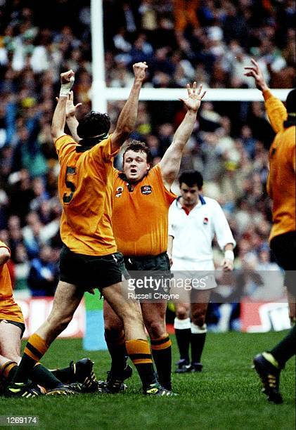 John Eales and Tony Daley of Australia celebrate as the final whistle is blown during the World Cup final against England at Twickenham in London...