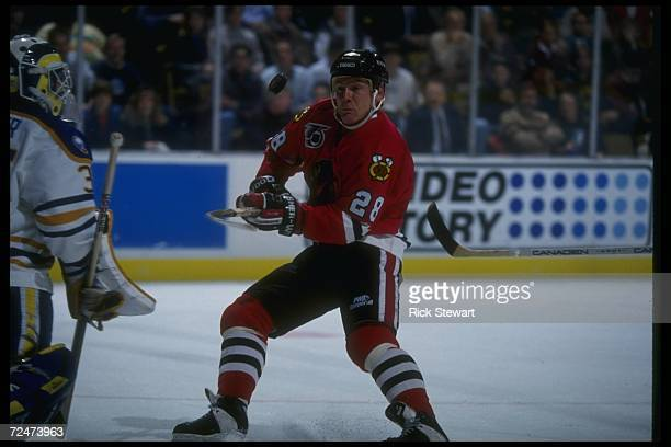 Rightwinger Steve Larmer of the Chicago Blackhawks works against the Buffalo Sabres during a game at Memorial Auditorium in Buffalo New York...