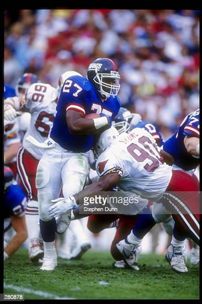Running back Rodney Hampton of the New York Giants moves the ball during a game against the Phoenix Cardinals at Sun Devil Stadium in Tempe Arizona...