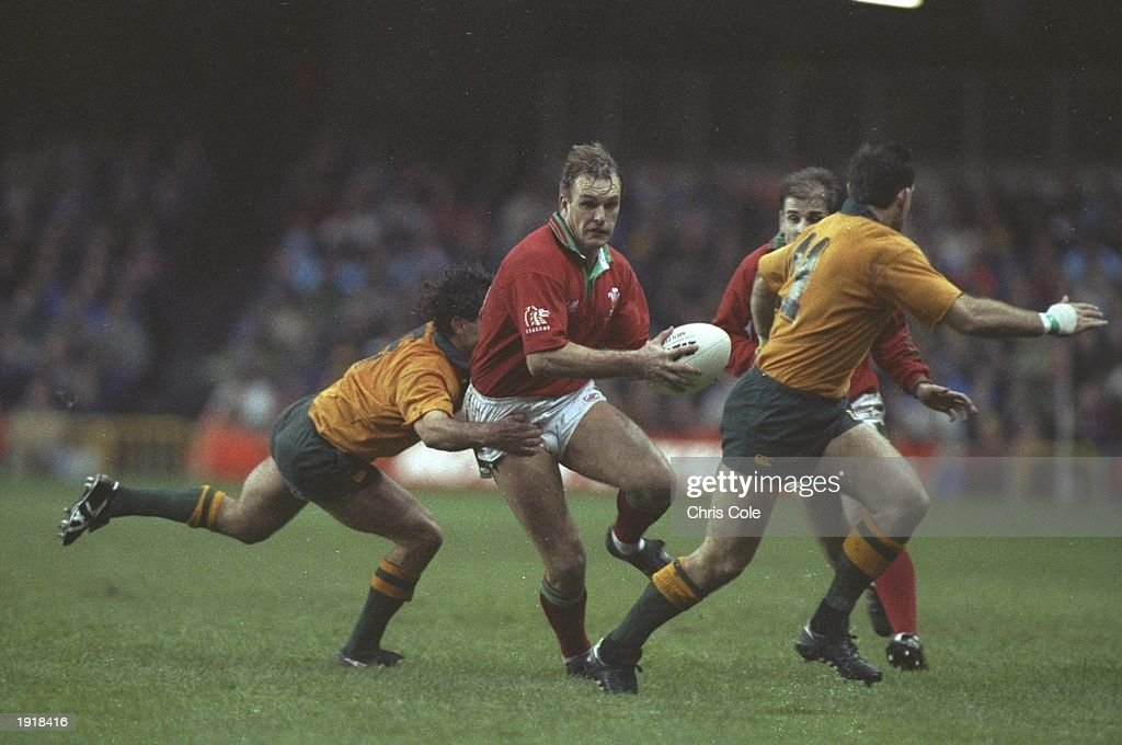 Mike Hall of Wales is tackled by Marty Roebuck of Australia in the Wales v Australia match : News Photo
