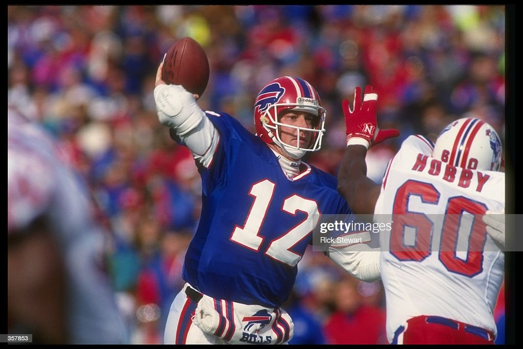 Quarterback Jim Kelly of the Buffalo Bills passes the ball during a game against the New England Patriots at Rich Stadium in Orchard Park, New York. The Bills won the game, 16-7. Mandatory Credit: Rick Stewart /Allsport