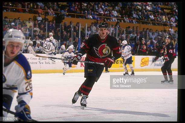 Center Alexei Yashin of the Ottawa Senators moves down the ice during a game against the Buffalo Sabres at Memorial Auditorium in Buffalo New York...