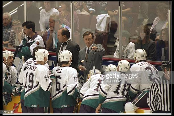 Head coach Ron Wilson of the Anaheim Mighty Ducks talks to his team during the Mighty Ducks versus San Jose Sharks game at the Arrowhead Pond in...