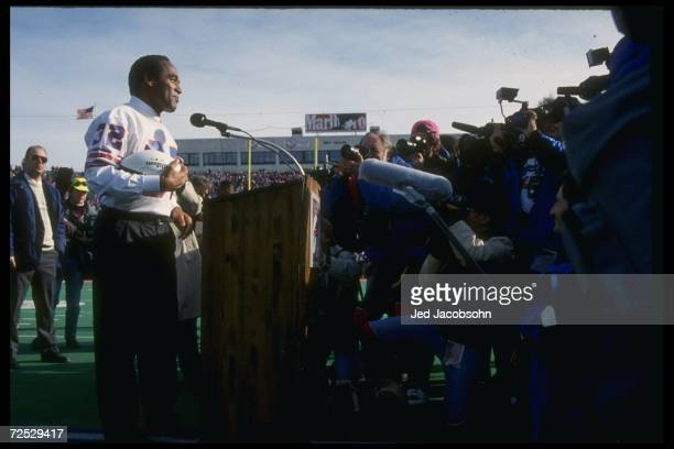 Simpson on the mike in a half-time ceremony during a game between the Buffalo Bills and the Indianapolis Colts at Rich Stadium in Orchard Park, New...