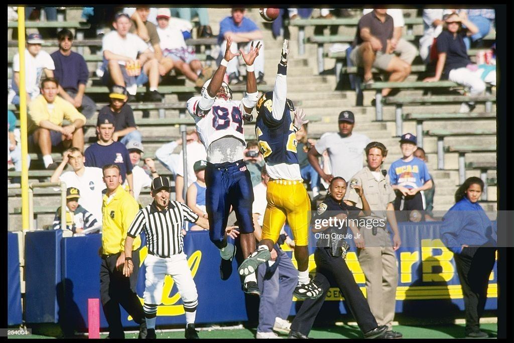 Wide receiver Troy Dickey of the Arizona Wildcats and defensive back Ike Booth of the California Bears jump up for the ball at Memorial Stadium in Berkeley, California. California won the game 24-20. Mandatory Credit: Otto Greule Jr. /Alls