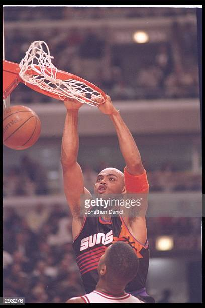 Forward Charles Barkley of the Phoenix Suns sinks the ball during a game against the Chicago Bulls at the United Center in Chicago Illinois The Bulls...