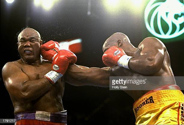 George Foreman and Michael Moorer trade blows during a bout in Las Vegas, Nevada. Foreman won the fight with a 10th round knockout. Mandatory Credit:...