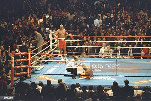 George Foreman wins a round during a bout against Michael Moorer in Las Vegas, Nevada. Foreman won the fight with a knockout in the tenth round....