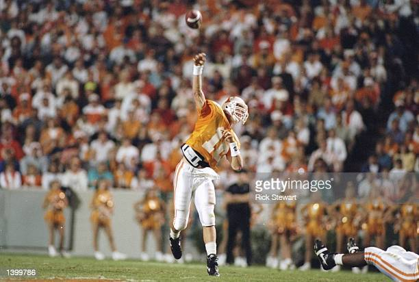 Quarterback Peyton Manning of the Tennessee Volunteers throws the football during a game against the Memphis Tigers at Neyland Stadium in Knoxville...