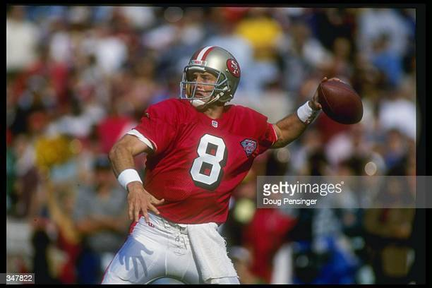 Quarterback Steve Young of the San Francisco 49ers looks to pass the ball during a game against the Washington Redskins at RFK Stadium in Washington...