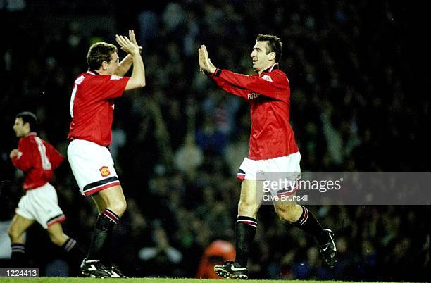 Steve Bruce and Eric Cantona of Manchester United celebrate with a ''high five'' during an FA Carling Premiership match against Manchester City at...
