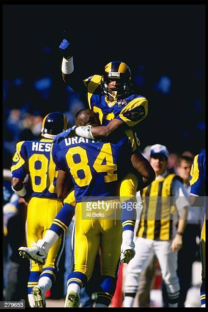Wide receiver Flipper Anderson of the Los Angeles Rams celebrates with teammates after scoring a touchdown during a game against the Los Angeles...