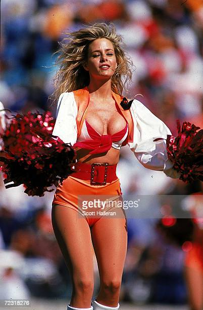 A cheerleaders for the Tampa Bay Buccaneers cheers during a game against the Jacksonville Jaguars at the Tampa Stadium in Tampa Bay Florida The...