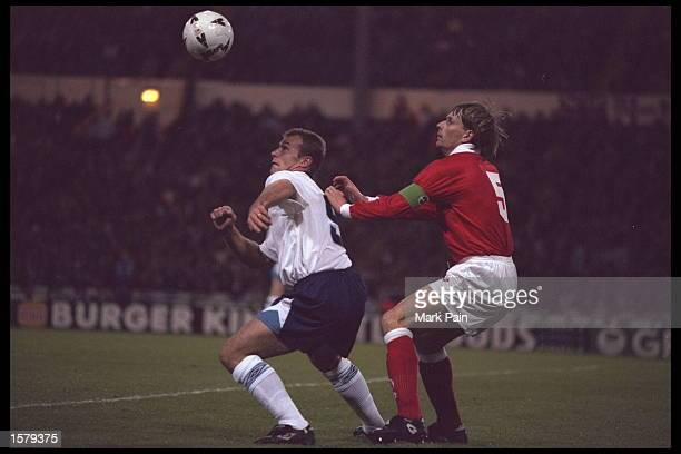 Alan Shearer of England is tackled by Alain Geiger of Switerland during the friendly international at Wembley stadium England beat Switzerland 31