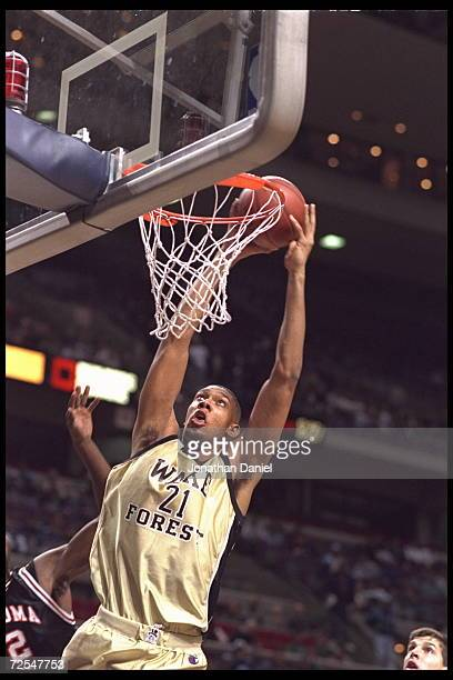 Center Tim Duncan of the Wake Forest Demon Deacons slams the ball at The Palace of Auburn Hills, Michigan, during the game against the Oklahoma State...