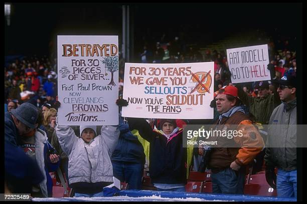 Cleveland Browns fans with signs look on during a game against the Houston Oilers at Cleveland Stadium in Cleveland Ohio The Oilers won the game 3710...
