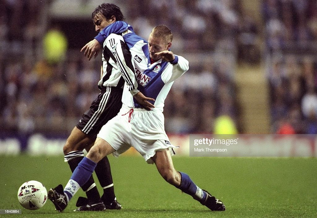 David Ginola of Newcastle United is tackled by David Batty of Blackburn Rovers during an FA Carling Premiership match at St James'' Park in Newcastle, England. Newcastle won the match 1-0. \ Mandatory Credit: Mark Thompson/Allsport