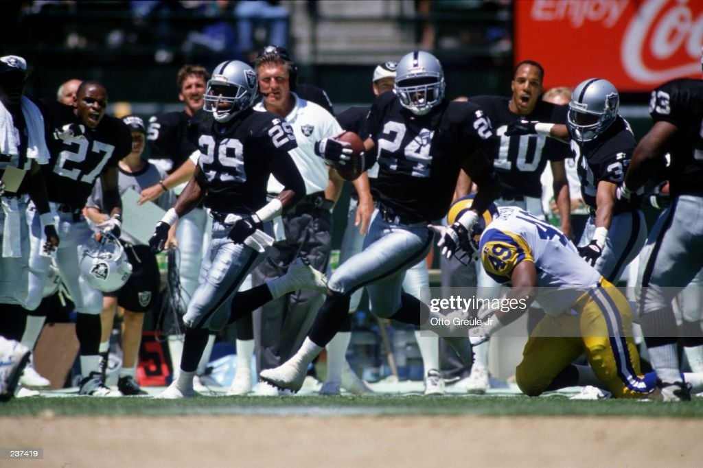 Defensive back Patrick Bates #24 of the Los Angeles Raiders carries the ball after intercepting a pass during the Raiders 27-22 win over the Los Angeles Rams at Memorial Coliseum in Los Angeles, California. Mandatory Credit: Otto Greule/ALLSP