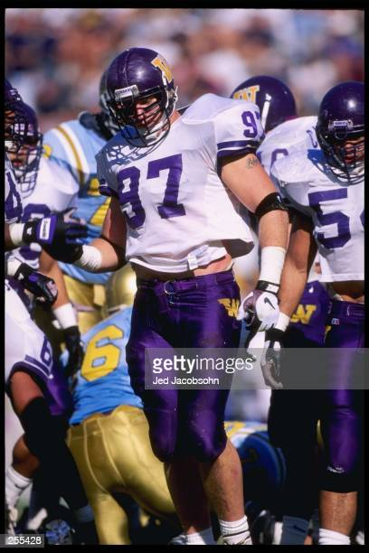 Defensive tackle David Riche of the Washington Huskies walks away from a play during a game against the California at Los Angeles Bruins at the Rose...