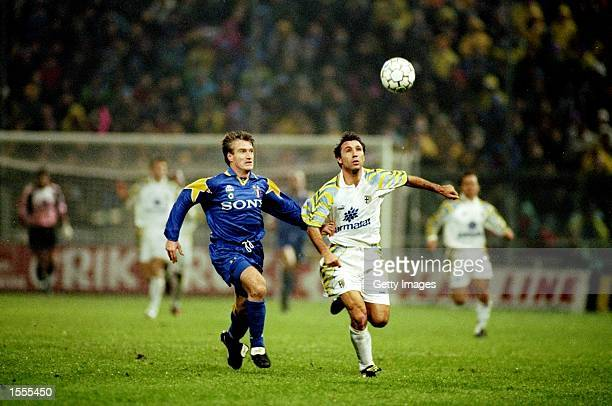 Didier Deschamps of Juventus holds back Hirsto Stoichkov of Parma during a Series A match at the Ennio Tardini Stadium in Parma Italy The match ended...