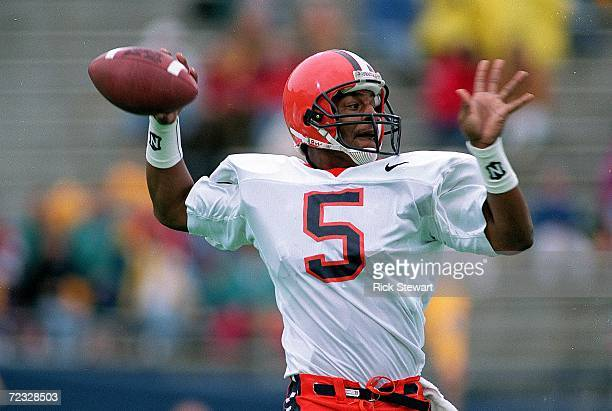 Donovan McNabb of the Syracuse Orangemen passes the ball during a game against the Pittsburgh Panthers at the Pitt Stadium in Pittsburgh Pennsylvania...