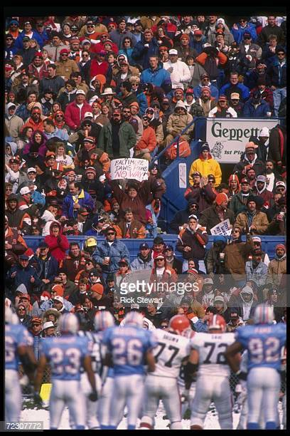 Fans cheer during a game between the Cleveland Browns and the Houston Oilers at Cleveland Stadium in Cleveland Ohio The Oilers won the game 3710...