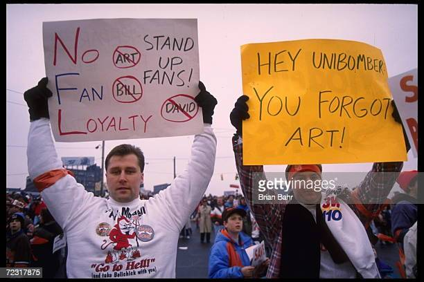 Fans hold various signs which accuses Cleveland Browns owner Art Modell of disregard of fans at Cleveland Stadium in Cleveland Ohio The Packers...