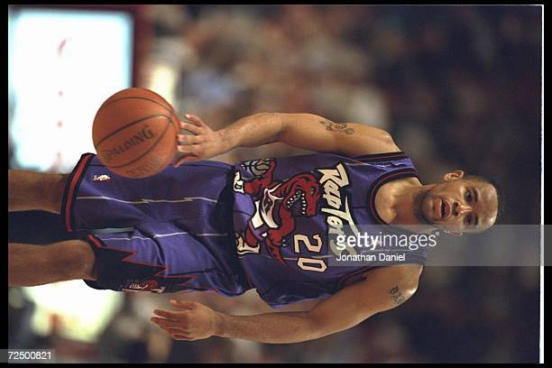 Guard Damon Stoudamire of the new expansion team Toronto Raptors dribbles down court to face the Chicago Bulls at the United Center in Chicago...