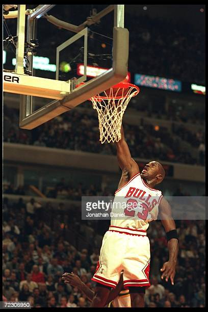 Guard Michael Jordan of the Chicago Bulls does a slam dunk to the joy of the crowd at the United Center in Chicago, Illinois during the game against...