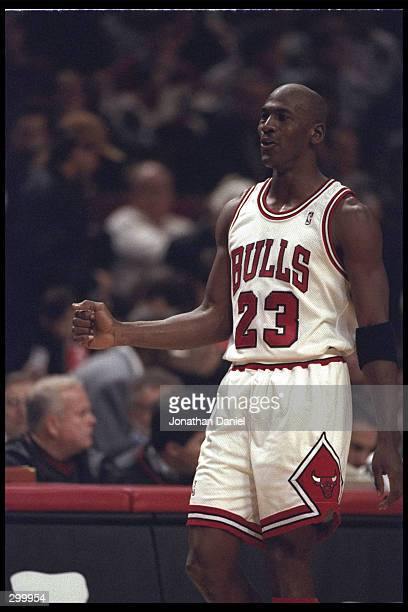 Guard Michael Jordan of the Chicago Bulls smiles on the sideline as his team rolls to victory against the Charlotte Hornets The Bulls defeated the...