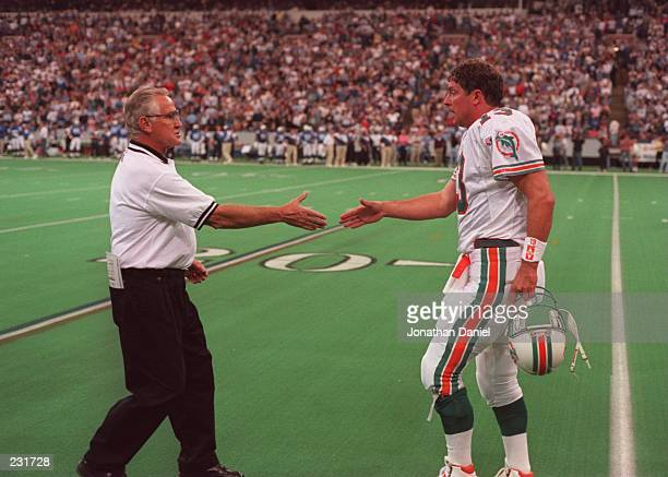 Head coach Don Shula congratulates quarterback Dan Marino of the Miami Dolphins during the Dolphins 3628 loss to the Baltimore Colts at the RCA Dome...