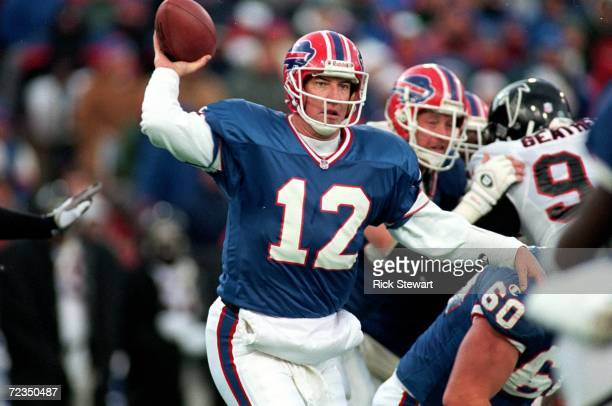 Jim Kelly of the Buffalo Bills gets ready to pass the ball during the game against the Atlanta Falcons at the Rich Stadium in Orchard Park New York...