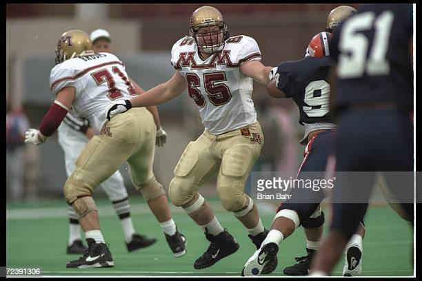 Offensive tackle Luke Herkenhoff of the Minnesota Golden Gophers looks for someone to block during a game against the Illinois Fighting Illini at...