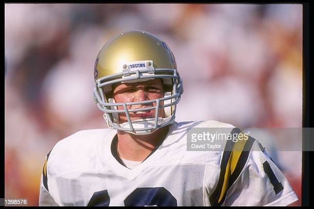 Quarterback Cade McNown of the California at Los Angeles Bruins stands on the field during a game against the Southern California Trojans at the Los...