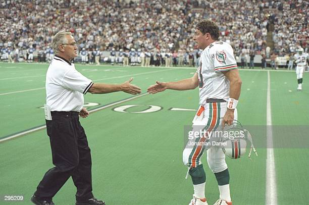 Quarterback Dan Marino shakes hands with coach Don Shula of the Miami Dolphins during a game against the Indianapolis Colts at the RCA Dome in...