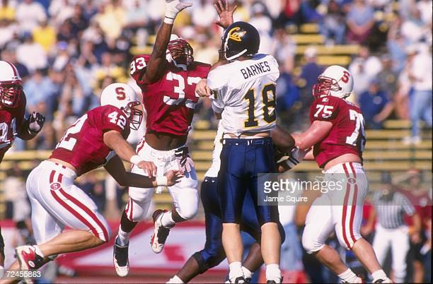 Quarterback Pat Barnes of the Cal Golden Bears follows through on a pass attempt as he is surrounded by several pursuing defenders from the Stanford...