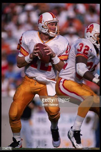 Quarterback Trent Dilfer of the Tampa Bay Buccaneers looks downfield for an open receiver during the Buccaneers 1716 victory over the Jacksonville...