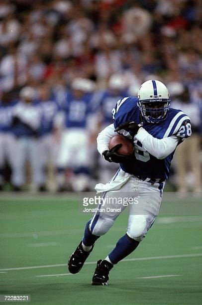 Running back Marshall Faulk of the Indianapolis Colts looks up field as he makes a cut to the outside during a carry in the Colts 3628 victory over...