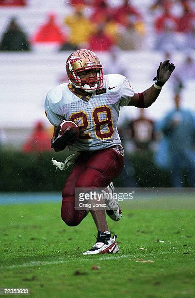 Warrick Dunn of the Florida State Seminoles carries the ball during a game against the North Carolina Tar Heels at the Kenan Stadium in Chapel Hill,...