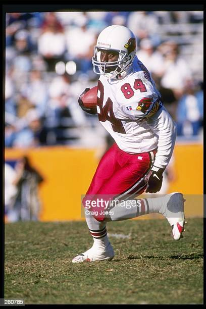 Wide receiver Marcus Dowdell of the Arizona Cardinals moves the ball during a game against the Carolina Panthers at Clemson Memorial Stadium in...