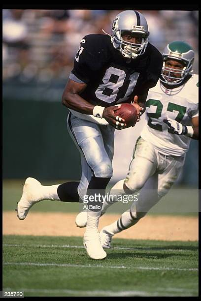 Wide receiver Tim Brown of the Oakland Raiders looks up field as he runs down the sideline following a reception in the Raiders 48-17 victory over...