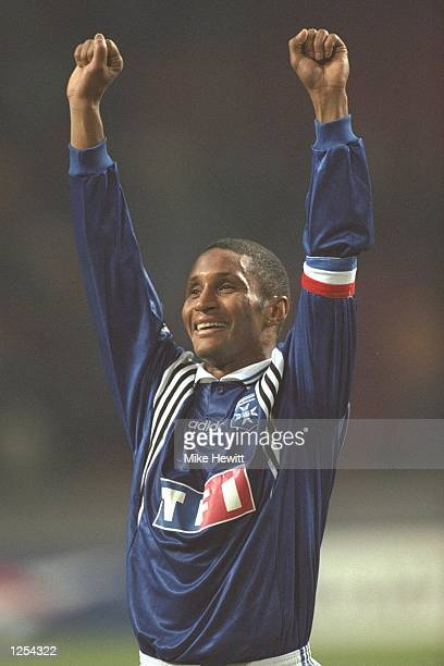 Alain Goma of Auxerre celebrates his teams victory during the champions league match between Ajax of Amsterdam and Auxerre in Amsterdam Holland The...