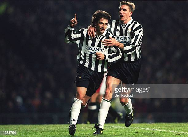 Alessandro Del Piero of Juventus is congratualted by teammate Alen Boksic after scoring a penalty to put Juventus 01 ahead of Manchester United...